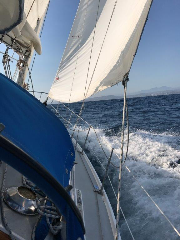 With reefed main and headsail, we aim toward Laguna Beach.