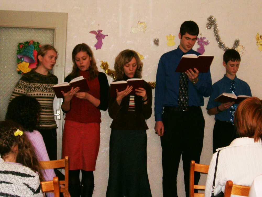 John leading songs in the local church in Belarus.