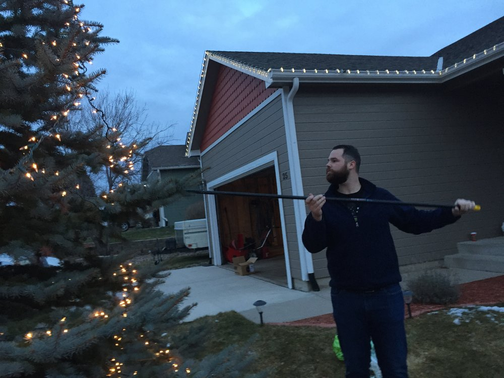 John putting up Christmas lights