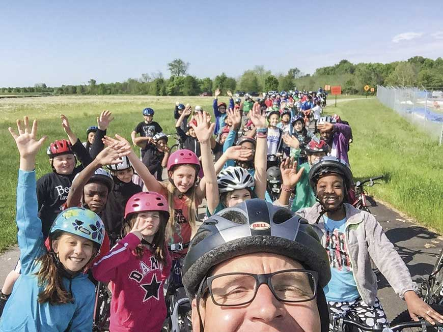 Nearly 200 fifth graders from Ashland Elementary in Lexington biked the Legacy Trail with Lexington Police Officer Howard Florence during a May field trip. (Photo submitted)