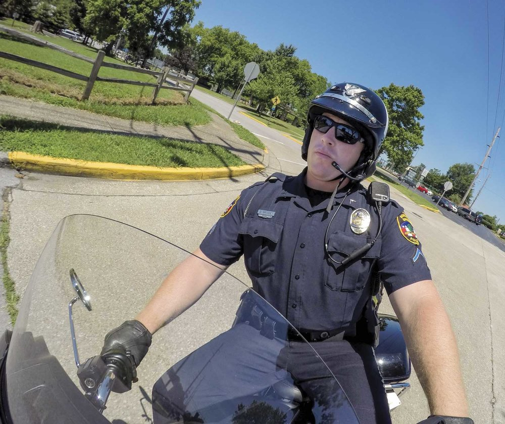 Bowling Green Police Motor Officer David Grimsley is one of four motorcycle officers for the department. BGPD's motorcycles not only work everyday patrol, they participate in various road races, parades and special events throughout the year. (Photo by Jim Robertson)