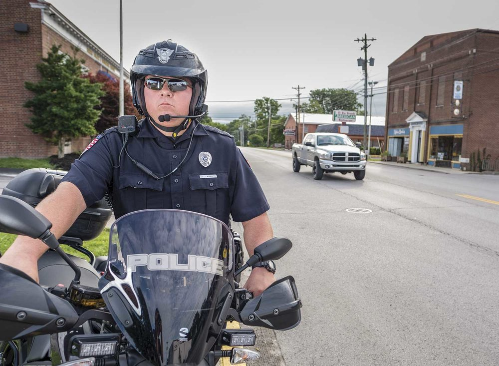 Closing out his second season of riding Berea's electric motorcycle, Officer Jason Kirby enjoys the flexibility motor patrol allows him. He has made new connections on the local college campus and sees the motorcycle as a great tool for patrolling Berea's numerous walking paths and bike trails.  (Photo by Jim Robertson)