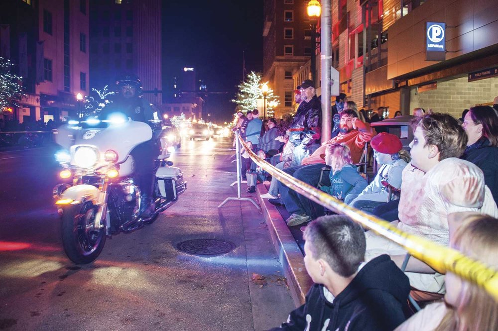 Lexington's Police Motorcycle Patrol Unit maintains order during the annual Thriller showcase in downtown Lexington. Keeping attendees safe on the sidewalks during special events is a primary function of the unit. (Photo by Jim Robertson)