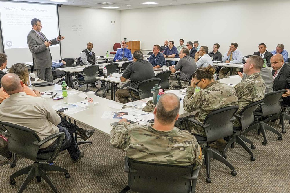KOHS convened state policy leaders, private sector experts and federal partners for a tabletop exercise simulating cyber attacks in state government. The training allows those involved to test and improve preparedness, the group said. (Photo by Jim Robertson)