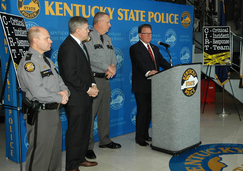 KSP Commissioner Rick Sanders at the news conference flanked by Deputy Commissioner Alex Payne, Justice and Public Safety Cabinet Secretary John Tilley and Maj. Jeremy Slinker.     -Photo by Les Williams