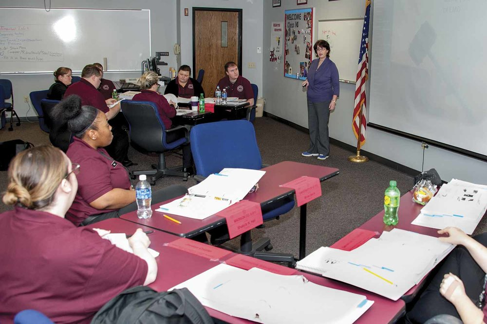 Shawn Herron and the other legal section instructors, provides legal instruction to nearly every type of student that passes through DOCJT. In Public Safety Dispatch Academy classes like this one, Herron teaches students basic intro to law, legal issues related to emergency medical dispatch and what happens in court, should they be called to court to testify. (Photo by Jim Robertson)