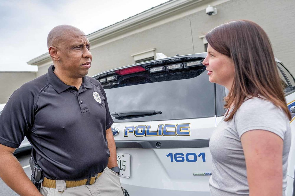 Danville Police Chief Tony Gray speaks with Detective Lisa Dollins outside the police department. Gray said his agency tries to nudge officers in the career path that best suits their individual skill sets. (Photo by Jim Robertson)