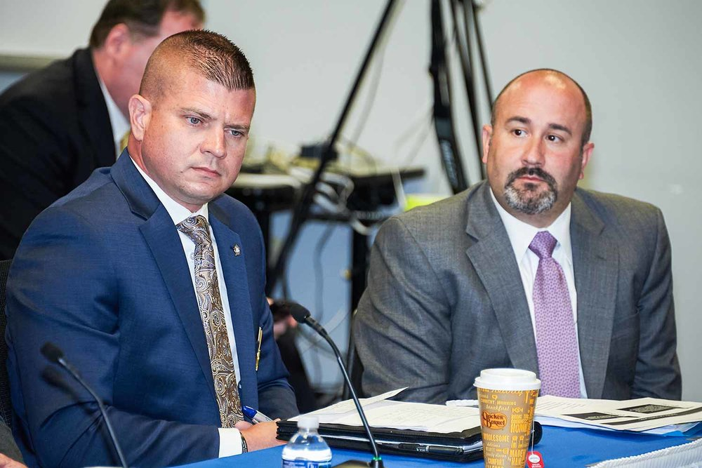 Louisville Metro Police Officer Nick Jilek, left, and Kentucky League of Cities Deputy Executive Director J.D. Chaney listen as House Rep. Robert Benvenuti discusses body-worn camera legislation. (Photo by Jim Robertson)