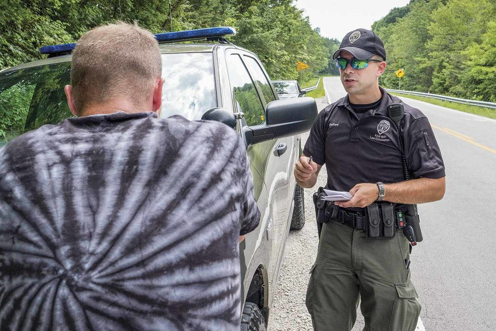 Conservation officer Brad Stafford's fishing compliance check on Gary Hogston quickly turned into a foot chase and subsequent man hunt for law enforcement officers in Rowan County. Hogston was eventually caught by members of the Morehead Police Department at his home later that evening. (Photo by Jim Robertson)