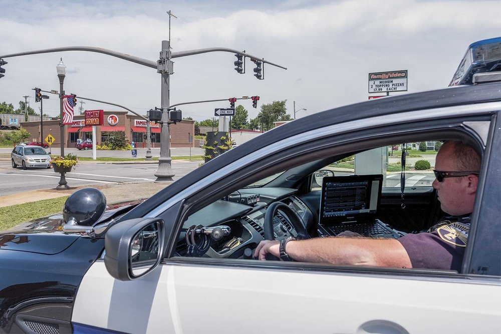 Based on predictions from the Lexis-Nexis predictive software, which layers information from all facets of collected data, Madisonville officers are strategically placed at high-collision areas at particular times of the day to help reduce accidents and injuries. (Photo by Jim Robertson)