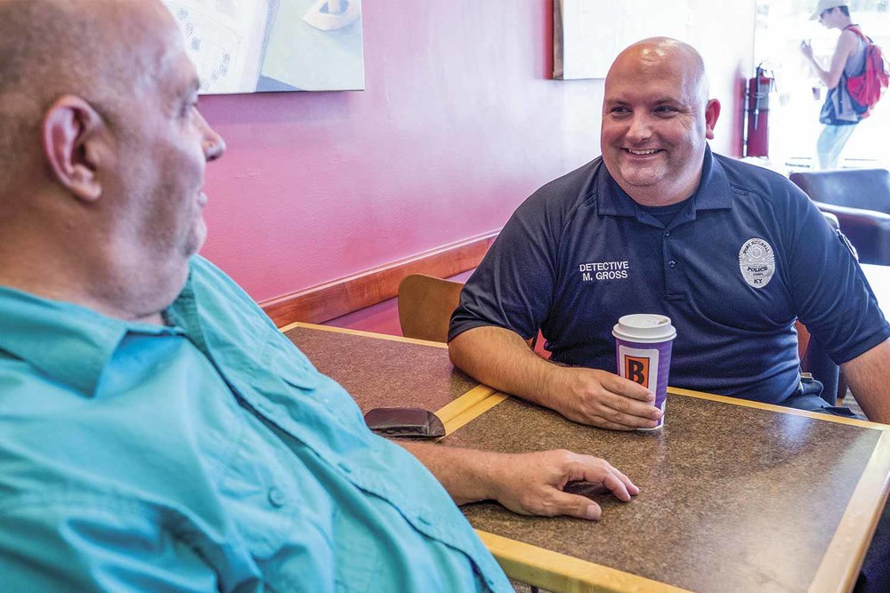 Fort Mitchell Police Sgt. Mike Gross takes a moment to chat with residents at his favorite coffee shop, Biggby Coffee. Biggby's and the police department work together regularly in support of their community. (Photo by Jim Robertson)