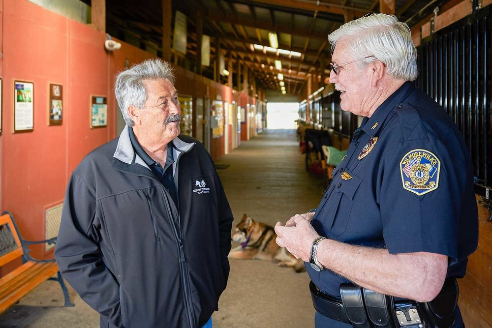 Wilmore Mayor Harold Rainwater, left, and Police Chief Bill Craig discuss city business at the Asbury University Equine Center where Rainwater is employed. (Photo by Jim Robertson)