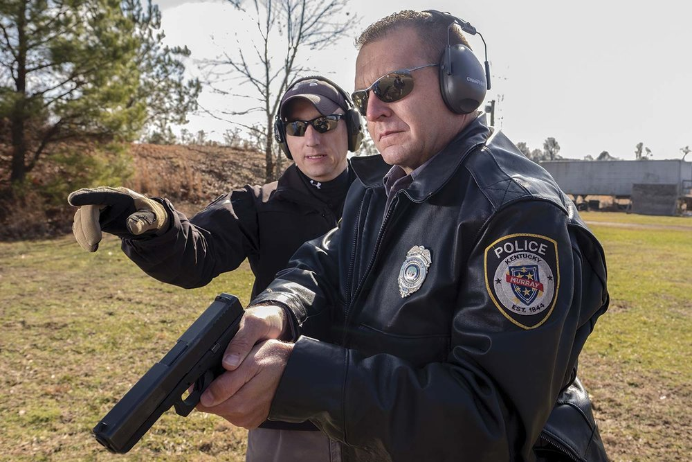 Murray Police Officer and firearms instructor Michael Weatherford, left, instructs MPD Officer Michael Robinson at the agency's firearms training range. Training is a priority for the Murray Police Department. The agency has multiple certified firearms instructors and maintains its own firearms training range for regular training. (Photo by Jim Robertson)
