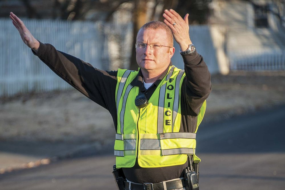 Murray Police School Resource Officer Patrick Morris directs morning traffic at Murray Middle School. The Murray Police Department employs three school resource officers – one each serving in a full-time capacity at the city's elementary, middle and high schools. (Photo by Jim Robertson)