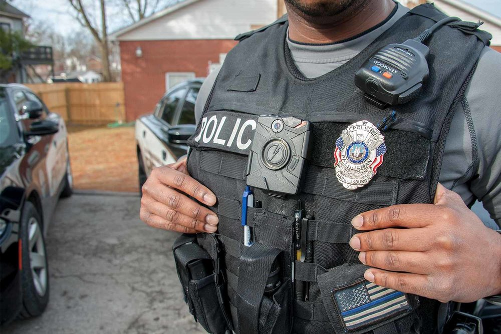 Harrodsburg Police Officer Chad Baker said the tactical-style overt vest allows for more customization of equipment carrying and storage while on duty. (Photo by Jim Robertson)