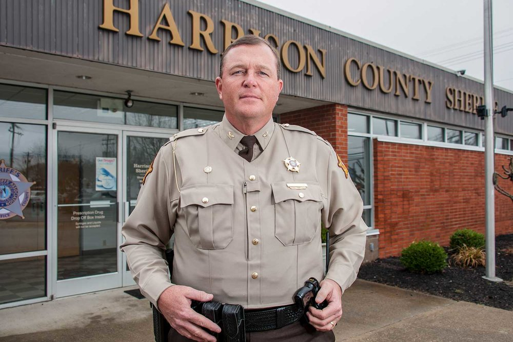 Harrison County Sheriff Shain Stephens demonstrates the overt vest that blends in to his department's uniform. (Photo by Jim Robertson)