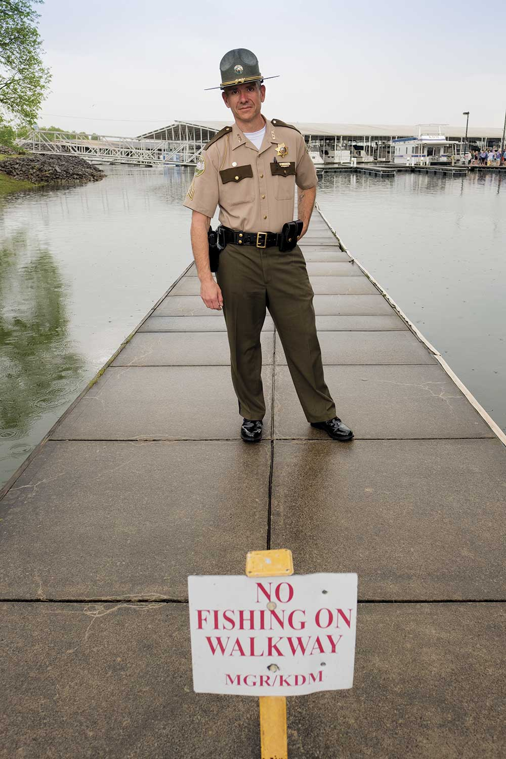 Kentucky Park Ranger Sgt. Randy Moore stands on a dock on Kentucky Lake at Kentucky Dam Village State Report Park in Marshall County. A solid knowledge of game laws and the outdoors is beneficial to park rangers, Moore said. (Photo by Jim Robertson)