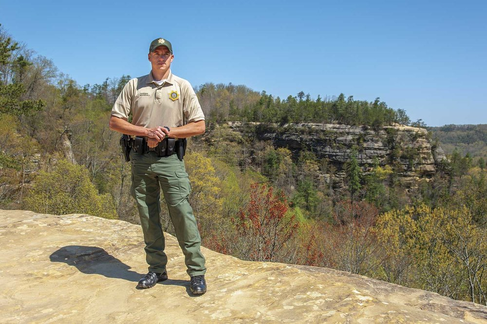 Kentucky Park Ranger Tim Marshall poses on top of Natural Bridge at the state park resort located in Powell, Lee and Wolfe counties. Natural Bridge State Resort Park is a 2,600-acre nature preserve known for its outstanding hiking trails. (Photo by Jim Robertson)