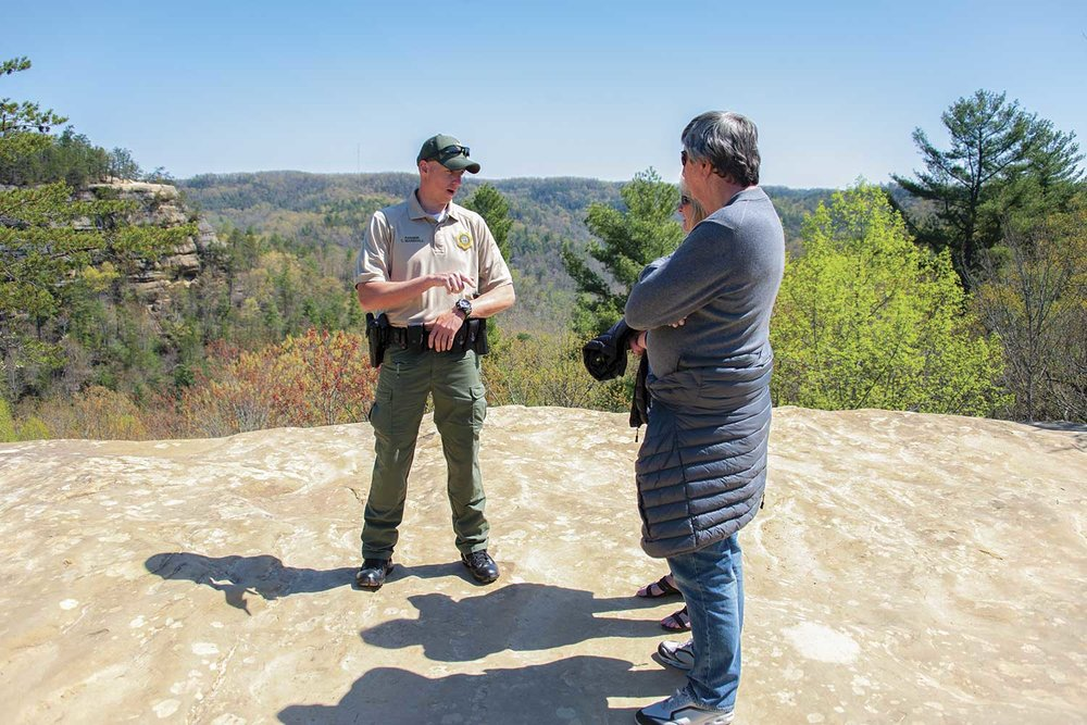 Kentucky Park Ranger Tim Marshall visits with tourists at Natural Bridge State Resort Park in early May. State parks are busy year-round, but tend to have spikes in visitors as the weather warms up and Natural Bridge is no different. (Photo by Jim Robertson)