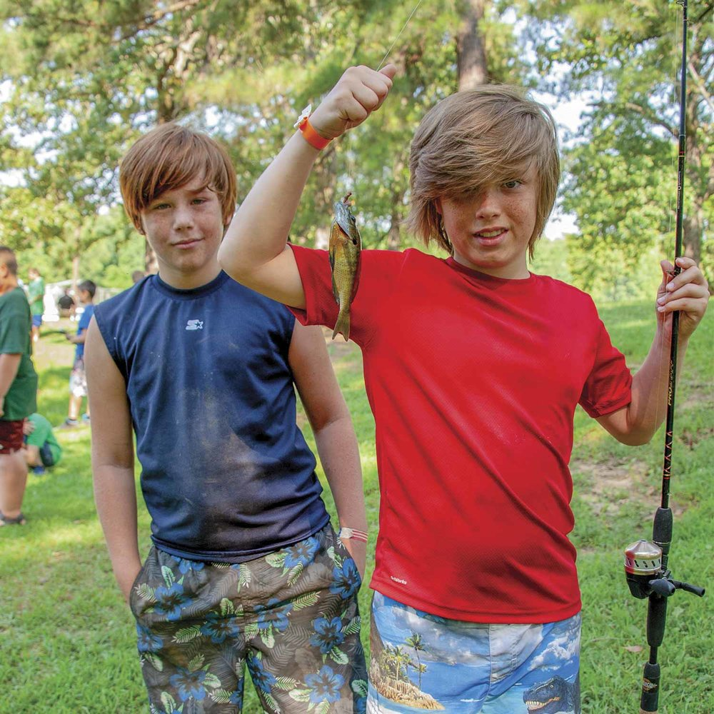Fishing is a popular activity at the Kentucky Sheriffs' Boys and Girls Ranch. One young boy showed off his catch of the day in mid-July. (Photo by Jim Robertson)