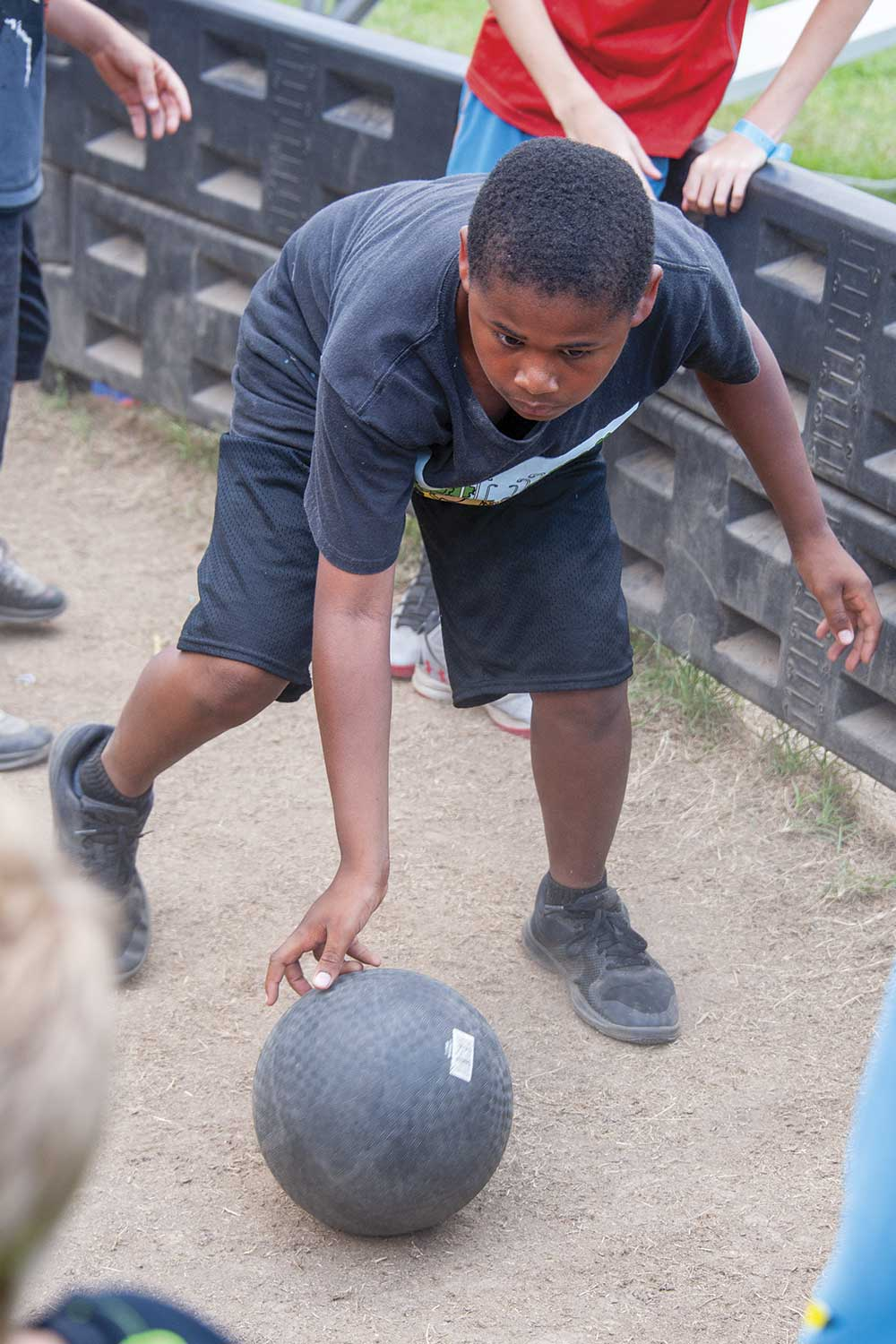 """The self-proclaimed """"King"""" of Gaga Ball, 11-year-old David Smalley of Marion County, demonstrates his skills in the Gaga Ball Pit at the Kentucky Sheriffs' Boys and Girls Ranch. (Photo by Jim Robertson)"""