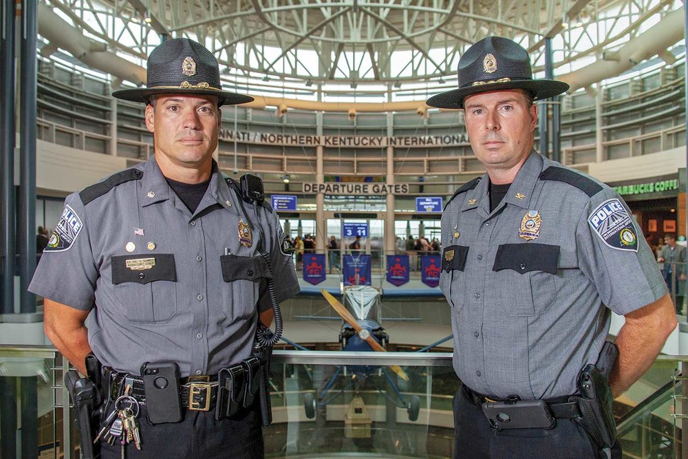 Cincinnati-Northern Kentucky International Airport Police Lt. Col. Steve Schmidt, left, and Chief Shawn Ward pose inside the airport, near the departure gates. (Photo by Jim Robertson)