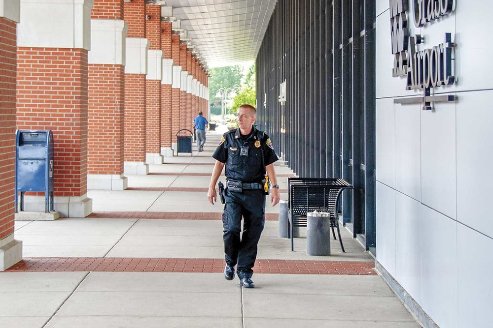 Blue Grass Airport Public Safety Capt. Keith Moore patrols outside the main terminal. (Photo by Jim Robertson)