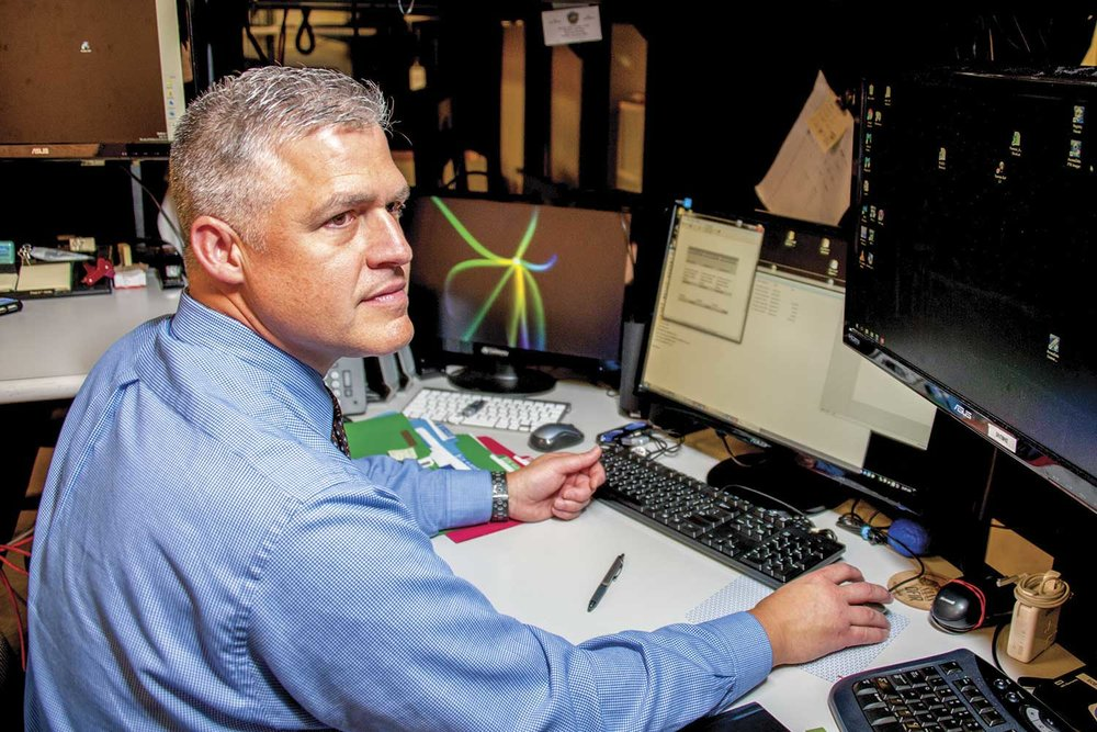 Kentucky State Police Detective Mike Viergutz, is one of two KSP sworn troopers who serve as forensics examiners at the Electronic Crimes Branch. In all, the ECB received 6,351 cyber-tips between 2012 and 2017. (Photo by Jim Robertson)