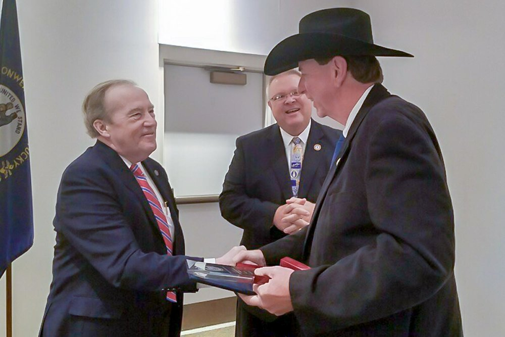 Daviess County Sheriff Keith Cain, right, receives the 2018 Melvin Shein award from Kentucky Law Enforcement Council Executive Director Fran Root, left, and Alexandria Police Chief Mike Ward, center.