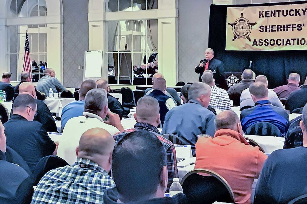 Marshall County Sheriff Kevin Byars speaks to a room full of law enforcement professionals during the Kentucky Sheriff's Association Conference at the Galt House in Louisville on Dec. 4. During the presentation, Byars and MCSO chief deputy David Maddox spoke on the tragic school shooting that rocked their Kentucky community in January and reflected how their agency responded. (Photo by the author)