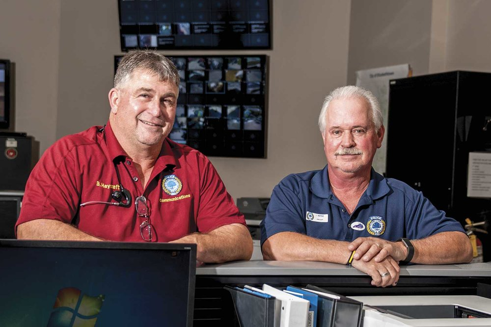 Elizabethtown Police Dispatch Supervisor, Darrell Brangers (right), is the longest-serving EPD employee. Dispatcher Billy Jo Haycraft (left) is just behind Brangers' record with 36 years of service. (Photo by Jim Robertson)