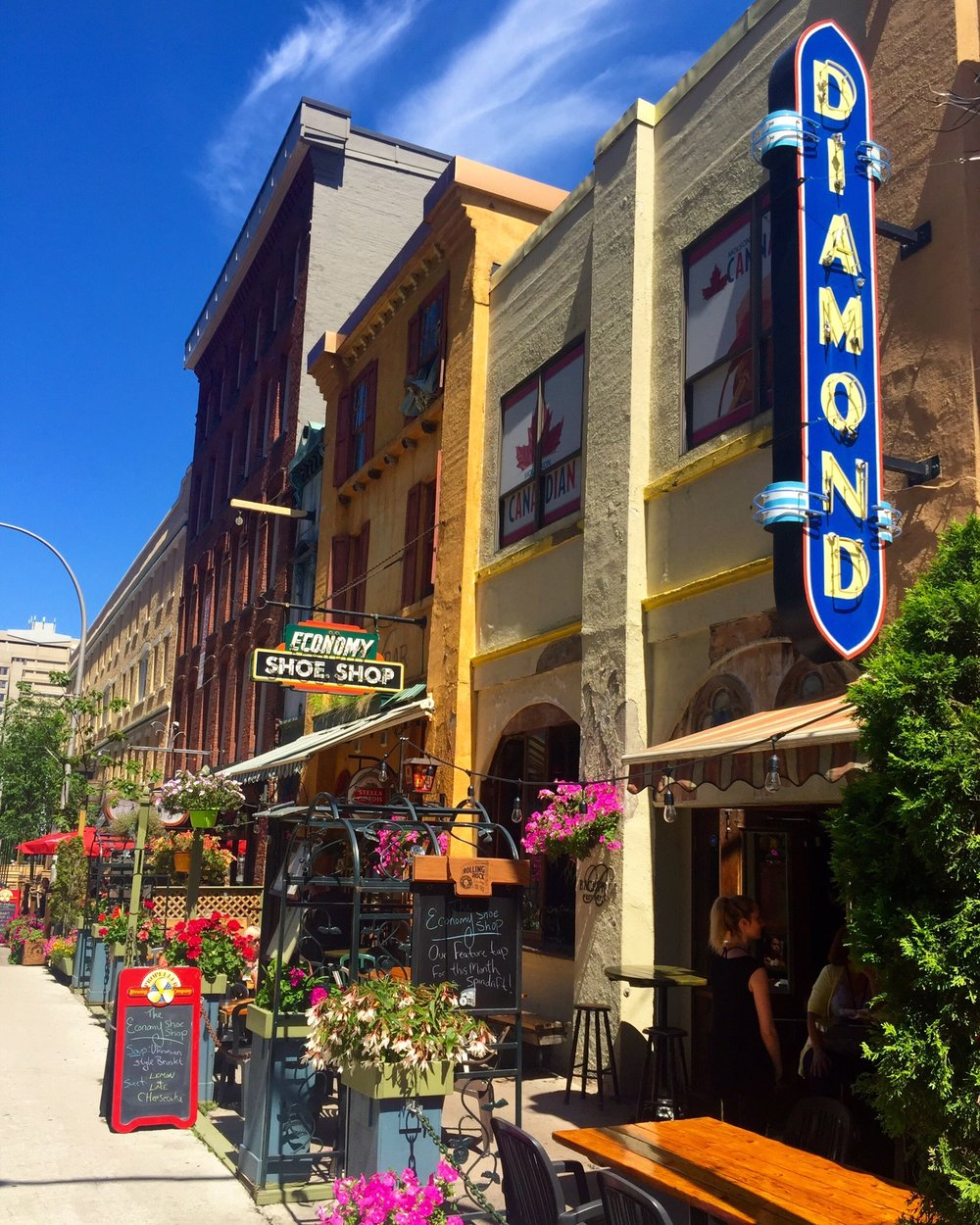 Argyle Street, in the heart of Halifax, Nova Scotia, is lined with cozy pubs, eccentric bistros (i.e. the iconic  Economy Shoe Shop , a cafe and bar that takes its name from a salvaged neon sign that hangs from the side of the building) and plenty of options for dining al fresco on a gorgeous summer day.