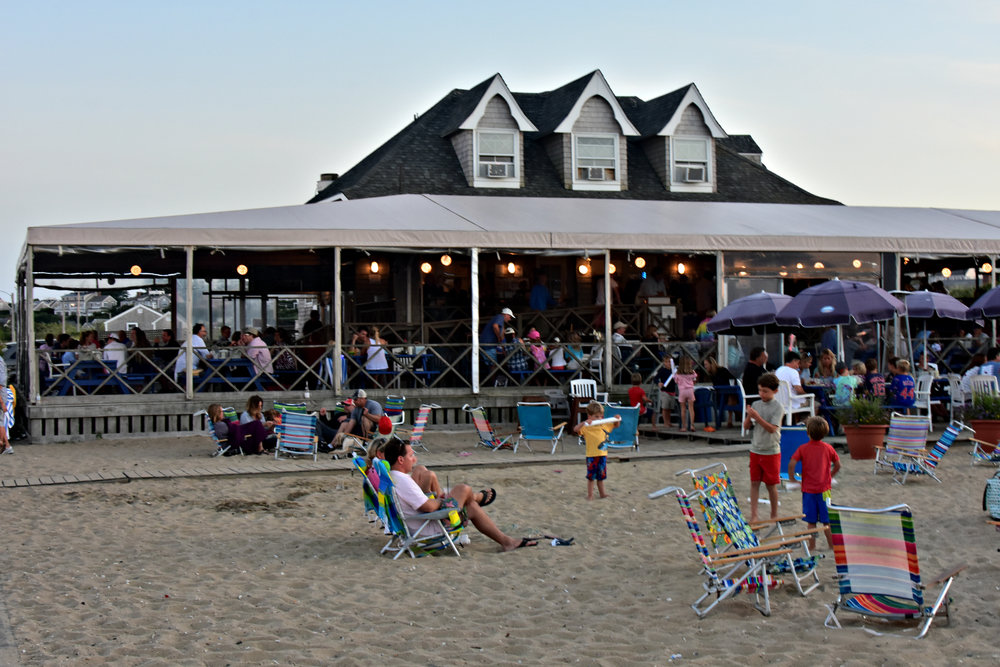 "Jetties Beach Bar & Restaurant is famous for their sunset ""buck-a-shuck"" - dollar oysters, clams and shrimp served with a view from 3-7 each evening."