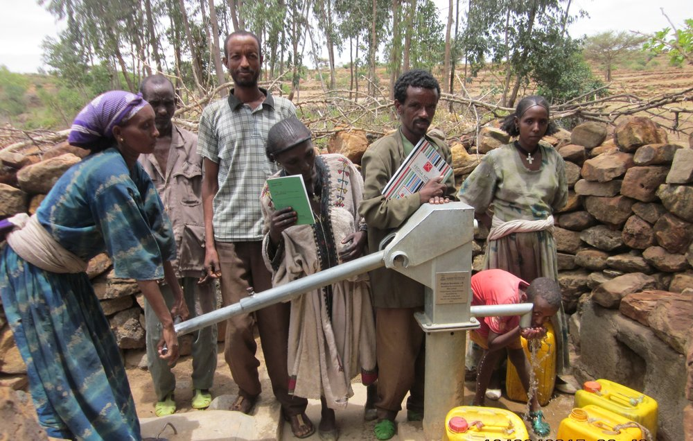 Residents of Dekera, Ethiopia trying out their freshwater well
