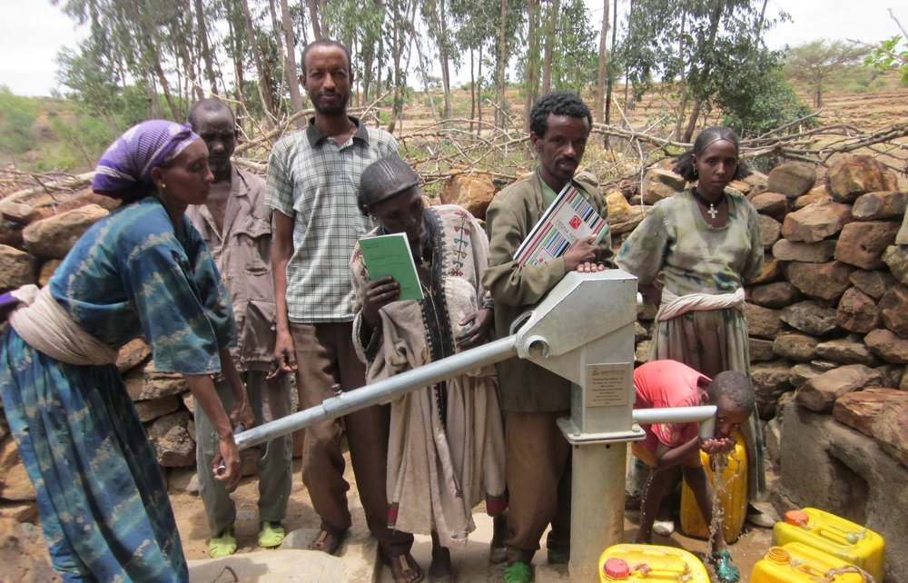 Recipients of Doc E's first well in northern Ethiopia pump freshwater for the first time.
