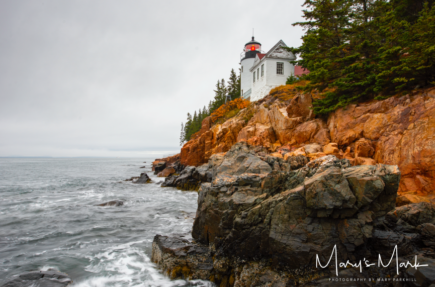 Acadia National Park, Maine   What this photograph does not capture are the jagged rocks and boulders between the end of the footpath and where I took this photograph. It was quite the adventure getting to this location but I think capturing this angle of the lighthouse was well worth it.