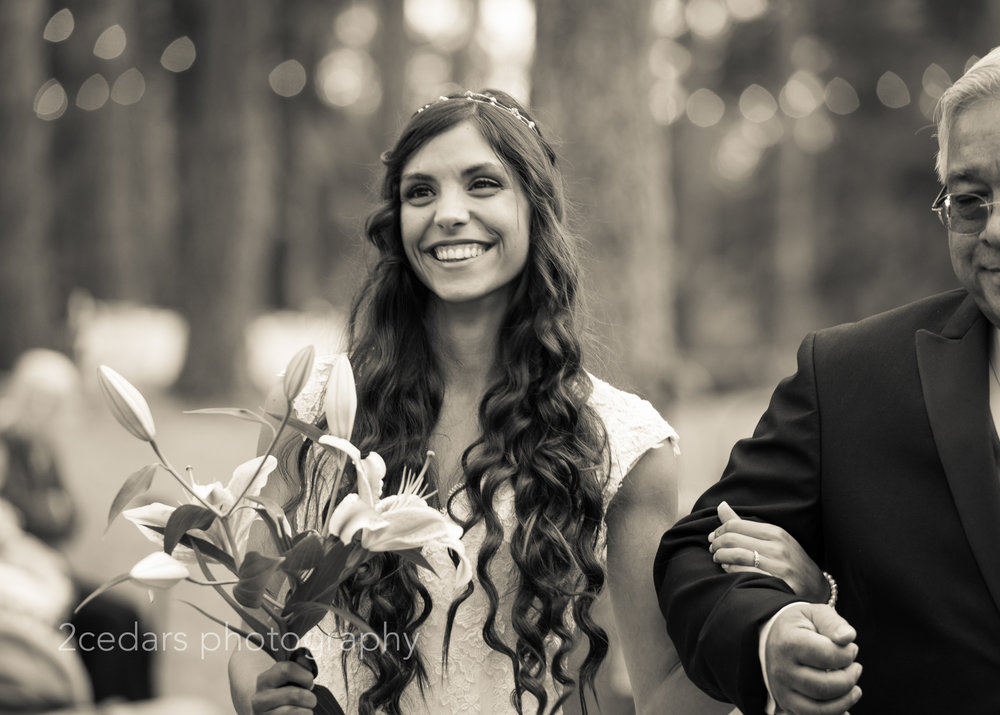 Black and white smiling bride with long hair