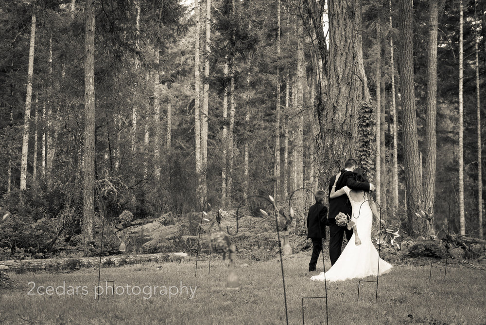 black and white bride and groom with son.