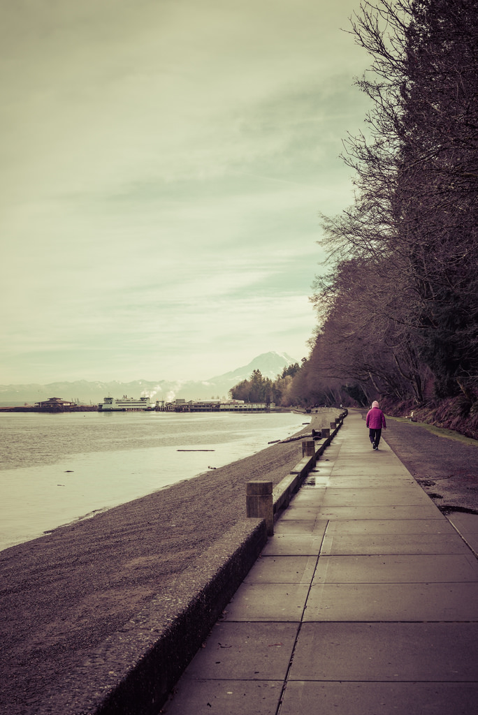 Woman on the Waterfront Path at Owen Beach in Point Defiance, Tacoma, WA