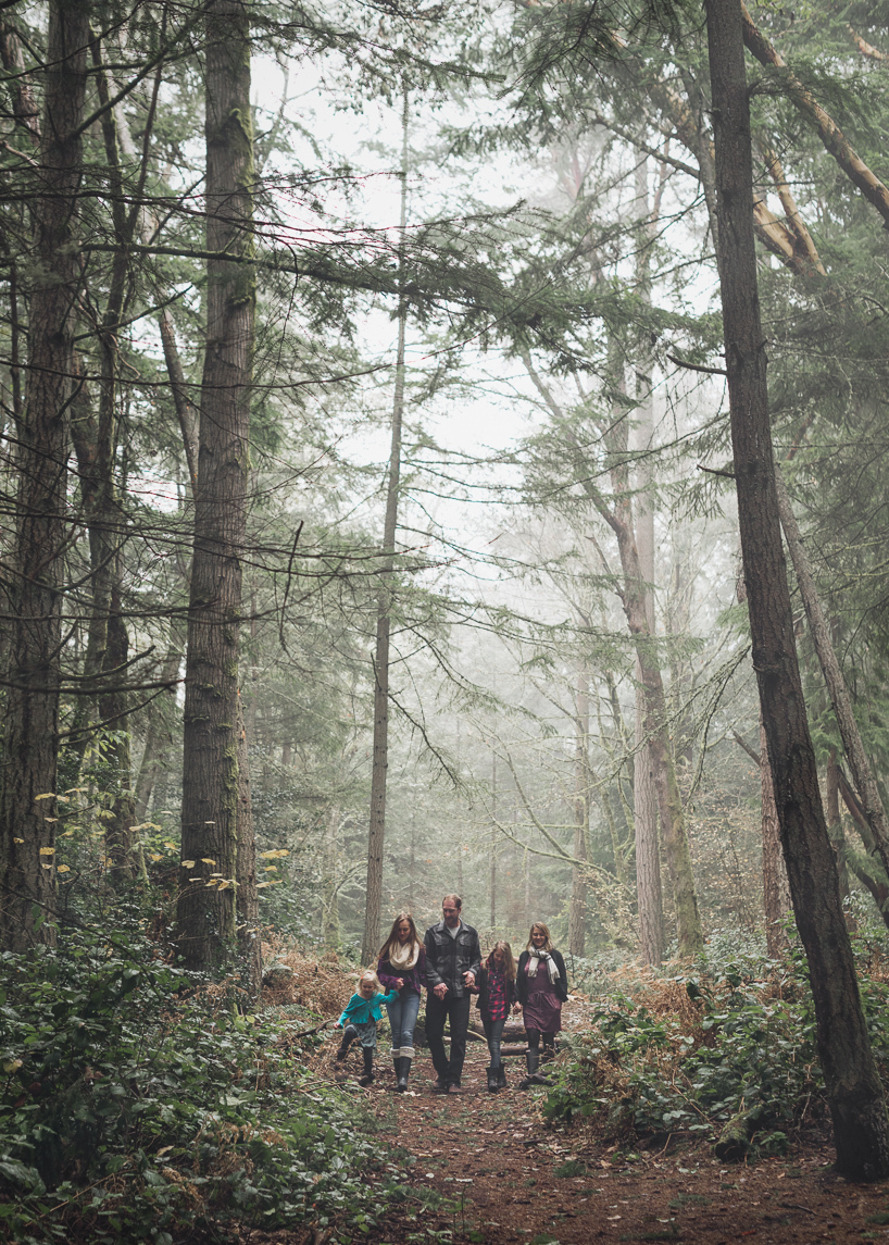 Family portrait in the forest near the Puget Sound in the Pacific Northwest