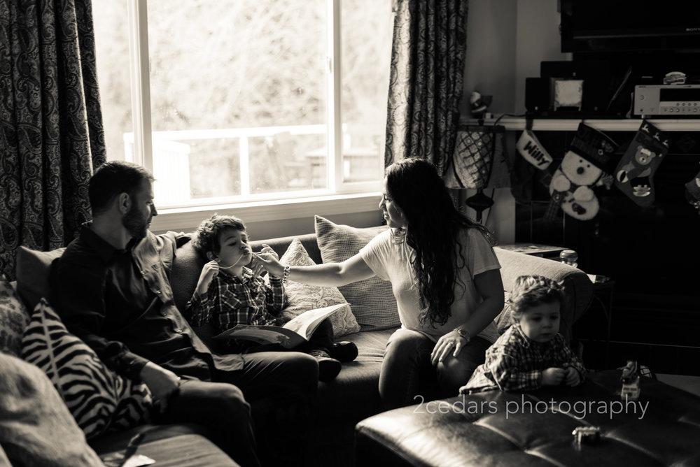 Black and white in-home photojournalistic family portrait in Tacoma, WA