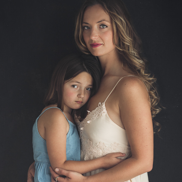 Mother daughter embrace formal portrait