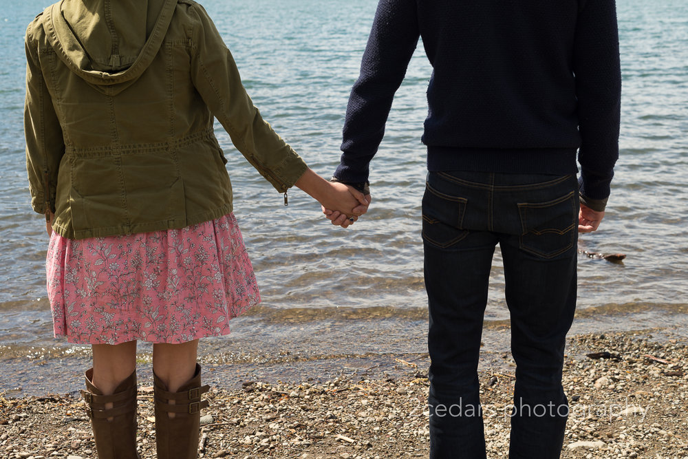 Couple Holding Hands at the Lake