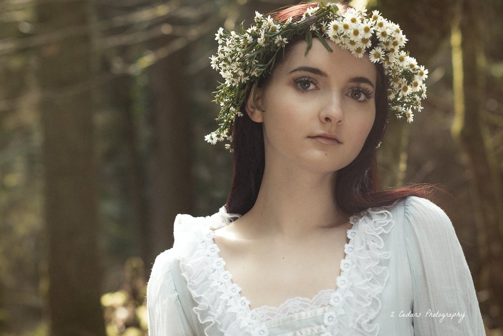 Vintage bride in flower crown in the forest