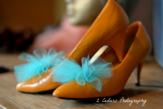 Orange shoes with turquoise pouf clips