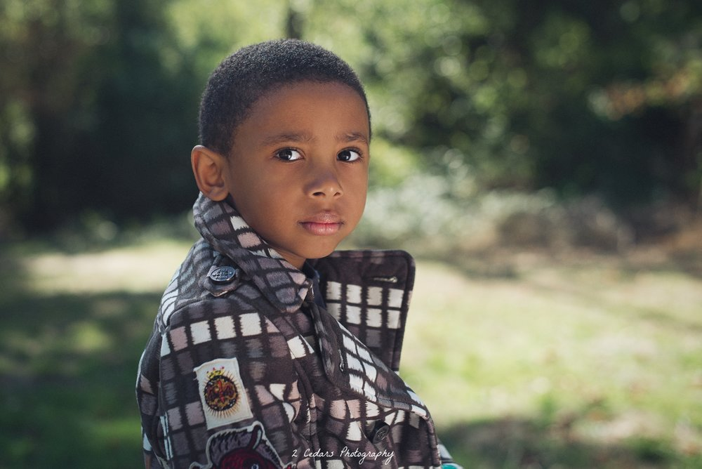Boy with bright eyes stunning outdoor portrait in Tacoma