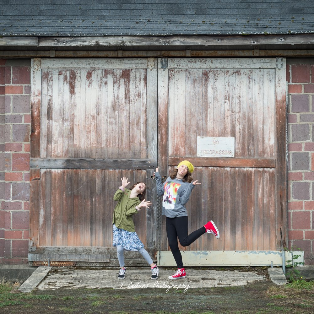 Silly portrait of sisters at Fort Steilacoom Park in University Place, WA