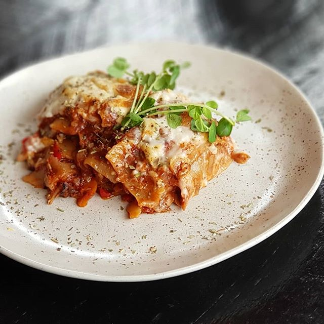 Lasagna... It's gluten free, vegan and totally delicious.  Available every day our doors are open. The perfect lunch or dinner, traditional Italian sauce flavoured with garlic, sage, thyme and bay, pureed over roasted eggplant, pumpkin, zucchini and mushroom. Topped with a smooth cheesy sauce, and baked to perfection.... #vegan #veganfood #health #healthfood #sozo #delicious #italian #lasagna #lunch #goldcoast #food #foodie #eat #plantbased