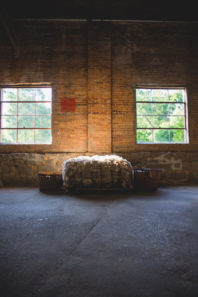 ABOVE:A bale of cotton sits in the warehouse as a nod to Hancock County's agricultural past.