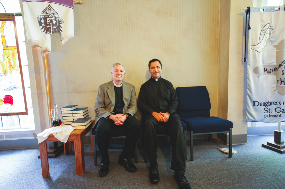 ABOVE: The Rev. Peter Wallace and Fr. Samuel Porras work together to build community